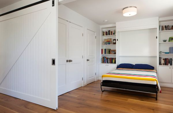 A-sliding-door-and-a-Murphy-bed-help-create-a-bedroom-out-of-nothing