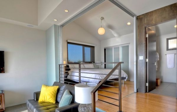 Innovative-use-of-sliding-doors-to-create-a-bedroom-in-an-open-floor-plan